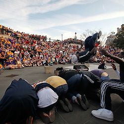 January 8, 2012; New Orleans, LA, USA;  Street performers Dragon Masters perform for a crowd of fans in the French Quarter following the Fan Fest pep rally for the 2012 BCS National Championship game to be played on January 9, 2012 between the Alabama Crimson Tide and the LSU Tigers at the Mercedes-Benz Superdome.  Mandatory Credit: Derick E. Hingle-US PRESSWIRE