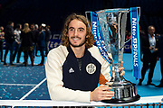 Stefanos Tsitsipas of Greece celebrates with his trophy during the Nitto ATP finals at the O2 Arena, London, United Kingdom on 17 November 2019.