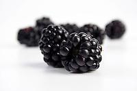 Studio shot of blackberries on white background