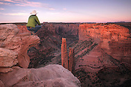 Christian Heeb looking over Spider Rock at last evening light, Canyon de Chelly National Monument, Arizona, USA