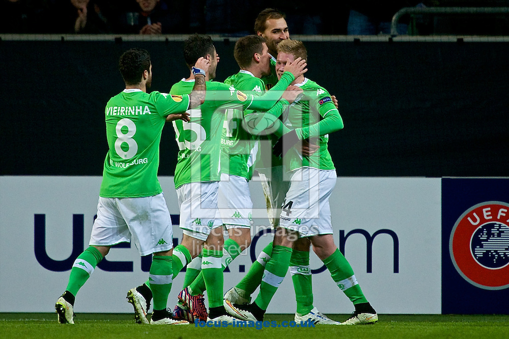 Bas Dost of VfL Wolfsburg (2nd right) celebrates scoring their second goal to make it VfL Wolfsburg 2 Sporting Clube de Portugal 0 during the UEFA Europa League match at Volkswagen Arena, Wolfsburg<br /> Picture by Ian Wadkins/Focus Images Ltd +44 7877 568959<br /> 19/02/2015