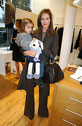 TRINNY WOODALL and her daughter LYLA ELICHAOFF at the launch party for the Comptoir des Cotonniers boutique, 235 Westbourne Grove, London W11 on 25th October 2006.<br />