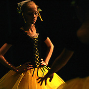 A young dancer pauses during a rehearsal of the Nutcracker ballet in Des Moines, Iowa.
