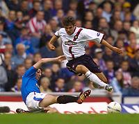 Photo. Jed Wee.<br /> Glasgow Rangers v Dundee, Scottish Premier League, Ibrox, Glasgow. 27/09/2003.<br /> Dundee's Nacho Novo (R) with Rangers' Shota Arveladze.