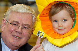 Repro Free: 21/03/2013 An Tánaiste Eamon Gilmore, with Luke O'Donnell (3) from Rathgar, Co.Dublin, puts his stamp of approval on the Irish Cancer Society's Daffodil Day, taking place nationwide tomorrow (Friday 22st March), pictured with a new postage stamp marking the 50th anniversary of the Irish Cancer Society, issued by An Post today.  .The Irish Cancer Society and Dell, lead partners for Daffodil Day, are calling on the Irish public to wear a daffodil today and support those affected by cancer in Ireland. Picture Andres Poveda.