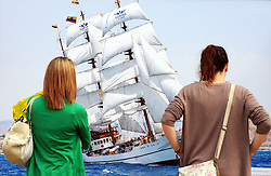 "© Licensed to London News Pictures. 05/09/2014<br /> Two women looking at ""Guayas in the parade of sail""  BY John Cadd at the <br /> Ships Shades Photography Exhibition at Old Royal Naval College,Greenwich.<br /> The Tall Ships festival 2014  starts today, marking the beginning of a week-long festival filled with wonderful displays on the River Thames at Greenwich.<br /> <br /> (Byline:Grant Falvey/LNP)"