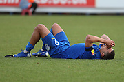 AFC Wimbledon striker Kweshi Appiah (9) down injured during the EFL Sky Bet League 1 match between AFC Wimbledon and Burton Albion at the Cherry Red Records Stadium, Kingston, England on 9 February 2019.