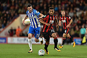 Brighton and Hove Albion midfielder Jamie Murphy (15) and AFC Bournemouth midfielder Jordan Ibe (33) challenge for the ball during the EFL Cup match between Bournemouth and Brighton and Hove Albion at the Vitality Stadium, Bournemouth, England on 19 September 2017. Photo by Adam Rivers.
