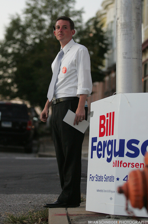 Sept 14, 2010; Baltimore, MD, USA; Maryland 46th District and former Baltimore City school teacher Bill Ferguson stands on the corner across from the poll in Canton. Ferguson, 27, is running against 27-year incumbent George Della, Jr. Mandatory Credit: Brian Schneider-www.ebrianschneider.com