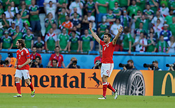 PARIS, FRANCE - Saturday, June 25, 2016: Wales' Hal Robson-Kanu celebrates at the final whilst after the 1-0 victory over Northern Ireland during the Round of 16 UEFA Euro 2016 Championship match at the Parc des Princes. (Pic by David Rawcliffe/Propaganda)