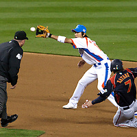 23 March 2009:  #7 Yasuyuki Kataoka of Japan steals second base over #16 Ki Hyuk Park of Korea in the seventh inning during the 2009 World Baseball Classic final game at Dodger Stadium in Los Angeles, California, USA. Japan defeated Korea 5-3