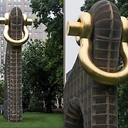 Renowned American sculptor Martin Puryear &quot; Big Bling&quot;, a major sculpture in Madison Square Park through January 8, 2017. The temporary outdoor work,  is a multi-tier wood structure wrapped in fine chain-link fence. A gold-leafed shackle is anchored near the top of the structure. At forty feet high, Big Bling achieves colossal scale and elicits a range of readings, stimulating diverse and profound interpretations of its meaning.<br /> <br /> Big Bling is part animal form, part abstract sculpture, and part intellectual meditation. The artist&rsquo;s signature organic vocabulary appears in a graceful, sinewy outline and an amoeboid form in the work&rsquo;s center. The piece is kind of Trojan horse,&rdquo; <br /> <br /> The term &ldquo;bling&rdquo; is rooted in urban youth and rap culture of the 1990s and refers to flashy jewelry and accessories.
