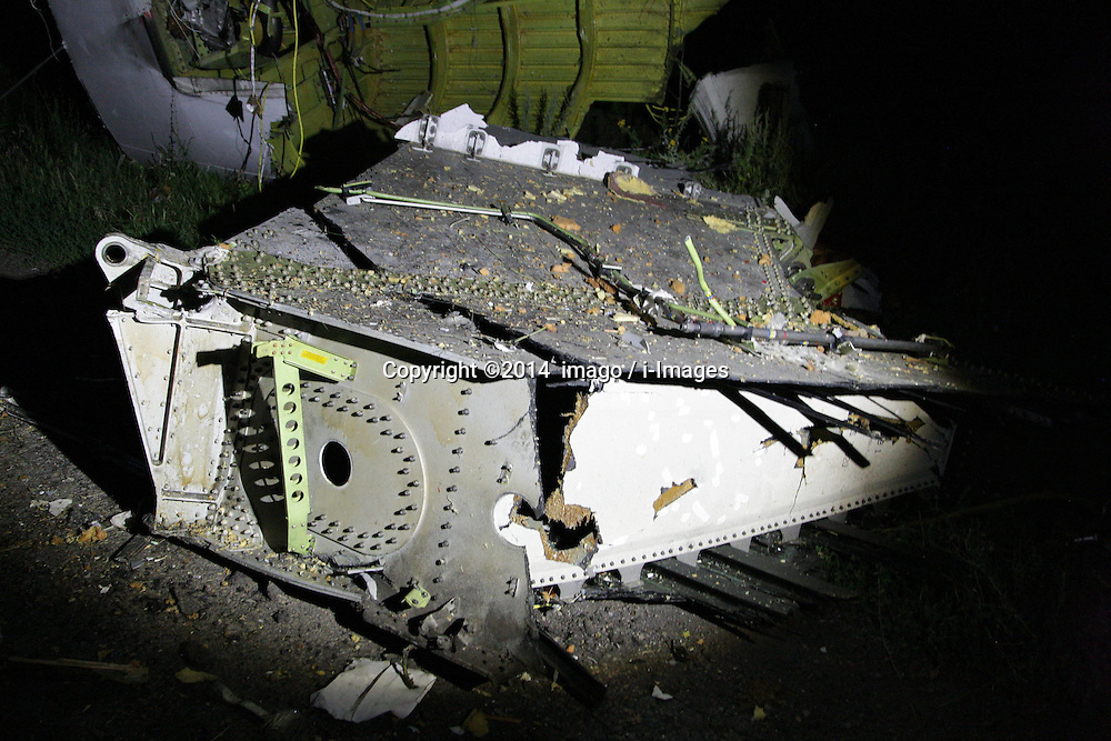 Image ©Licensed to i-Images Picture Agency. 17/07/2014.<br /> 61849949<br /> Shakhtarsk, Ukraine. The debris at the crash site of a passenger near the city of Shakhtarsk in Ukraine's Donetsk region. The crash of a Malaysian passenger plane in Ukraine on Thursday was shrouded in mystery of a deliberate attack, with Kiev trading accusations of blame with separatists and Moscow. Photo by imago / i-Images.<br /> <br /> UK ONLY