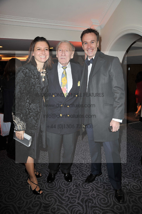 Left to right, JANE WAREING, LESLIE PHILLIPS and MARCUS WAREING at Quintessentially's 10th birthday party held at The Savoy Hotel, London on 13th December 2010.
