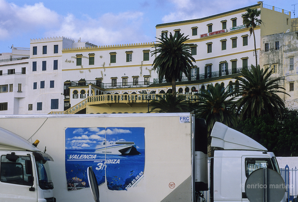 Tangier, El-Minzah hotel, once a Moorish style mansion build by lord Bute. In the thirties was a smart set for spies, bilionaires and adventurers. In the foreground the trucks waiting for the ferry sailing to the Spain.