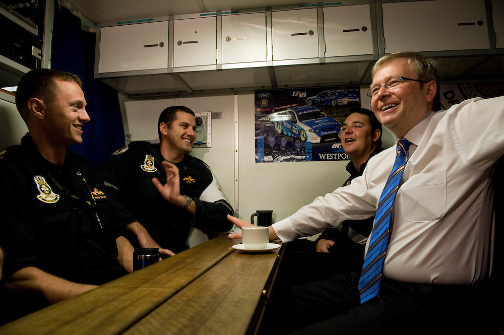 Australian Prime Minister Kevin Rudd talks with crew aboard the submarine HMAS Collins at Garden Island, Western Australia.