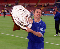 Dennis Wise (Chelsea) with the Charity Shield. Chelsea v Manchester United. FA Charity Shield. Wembley 13/8/00. Credit: Colorsport.