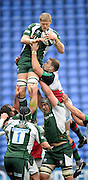 Reading, GREAT BRITAIN, right Quins' George ROBSON tackles Exiles' James HUDSON as he cllects the line out ball, during the Guinness Premiership game, London Irish vs Harlequins, 19.04.2008 [Mandatory Credit Peter Spurrier/Intersport Images]