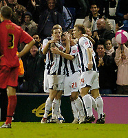 Photo: Leigh Quinnell.<br /> West Bromwich Albion v Coventry City. Coca Cola Championship. 16/12/2006. West Broms Kevin Phillips is congratulated by his team mates on goal number four for West Brom.