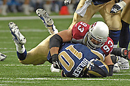 St. Louis Rams quarterback Marc Bulger (10) is sacked and thrown to the ground by Arizona defensive end Chris Cooper (93) in the fourth quarter, at the Edward Jones Dome in St. Louis, Missouri, December 3, 2006.  The Cardinals beat the Rams 34-20.<br />