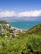 High-angle view overlooking Tata Beach, Tata Bay and Golden Bay visible, and the Wakamarama Range n the background