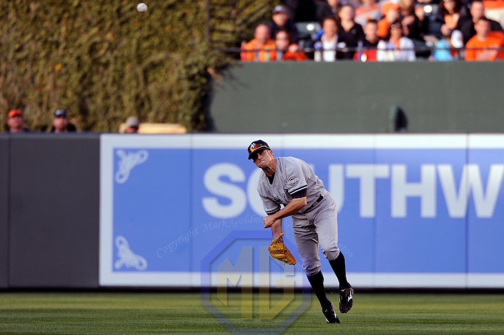 06 April 2009:  New York Yankees center fielder Brett Gardner (11) throws home in the 5th inning after catching a fly ball off the bat of Baltimore Orioles catcher Gregg Zaun to double up Baltimore Orioles third baseman Melvin Mora at home plate  at Camden Yards in Baltimore, MD.  The Orioles defeated the Yankees 10-5 in the home opener to start the major league regular season.  ****For Editorial Use Only****