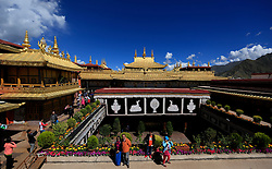 A picture made available on 19 September 2016 of tourist posing for photos in the Jokhang Temple in the late afternoon in Lhasa, Tibet Autonomous Region, China, 10 September 2016. Jokhang Temple is considered one of the most sacred site for Tibetan buddhists built during the rule of King Songtsen Gampo in the 7th century.