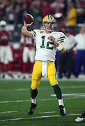 Green Bay Packers quarterback Aaron Rodgers (12) throws a second quarter pass for a completion in the red zone during the NFL NFC Divisional round playoff football game against the Arizona Cardinals on Saturday, Jan. 16, 2016 in Glendale, Ariz. The Cardinals won the game in overtime 26-20. (©Paul Anthony Spinelli)