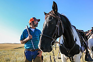 John Zeman, takes in the view with his horse Buckwheat  during a Montana grouse hunt.