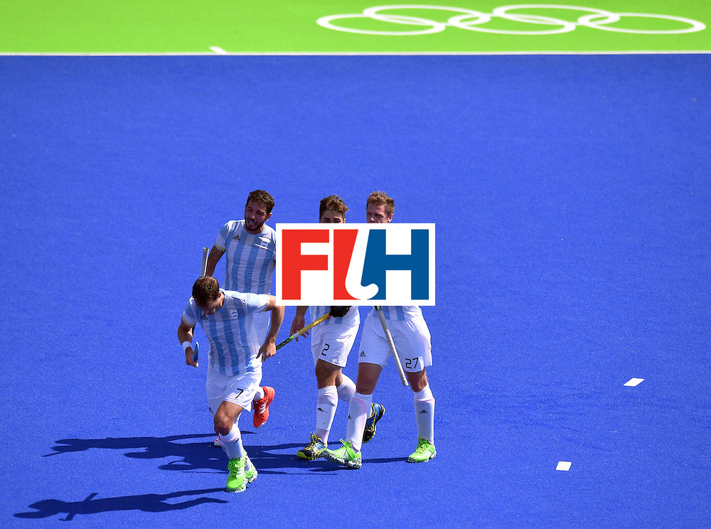 Argentina's Gonzalo Peillat (2nd R) celebrates his third goal with teammates during the men's semifinal field hockey Argentina vs Germany match of the Rio 2016 Olympics Games at the Olympic Hockey Centre in Rio de Janeiro on August 16, 2016. / AFP / Carl DE SOUZA        (Photo credit should read CARL DE SOUZA/AFP/Getty Images)
