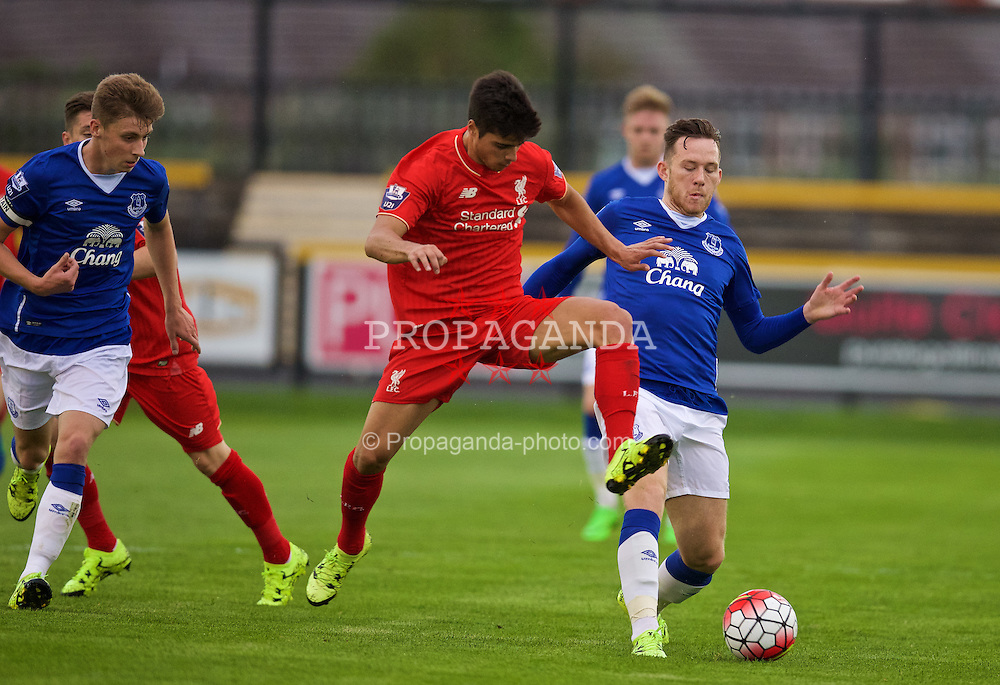 SOUTHPORT, ENGLAND - Wednesday, August 19, 2015: Liverpool's Joao Carlos Teixeira in action against Everton's Gethin Jones during the Under 21 FA Premier League match at Haig Avenue. (Pic by David Rawcliffe/Propaganda)