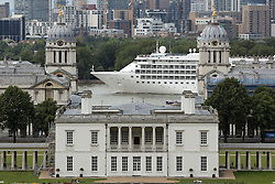 © Licensed to London News Pictures. 17/08/2015.  A large cruise ship has sailed up the Thames for a short visit to London. Silver Cloud, seen passing the maritime Greenwich and approaching the City, is 157 metres long and operated by Silverseas. She will be moored alongside HMS Belfast until Wednesday morning. Credit : Rob Powell/LNP