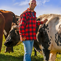 Organic farmer Mike Beretta with some of the cattle of his prize breeding herd. (Beretta Organic Farms, King City, Ontario, Canada).
