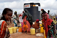 A crowd mingles next to a water station in Hagadera refugee camp in Dadaab, Kenya. An Internews information assessment found that over 30 percent of new arrivals need much more information about how to access water.