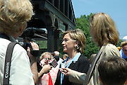 Chappaqua, NY, May 28: Hillary Clinton speaks with members of the press and others after the Memorial Day parade at the train station in her hometown of Chappaqua, New York.  Hillary Rodham Clinton was a United States Senator at the time (2006) and was Grand Marshall of the parade.