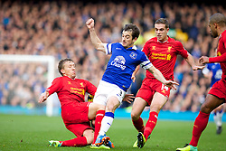 LIVERPOOL, ENGLAND - Saturday, November 23, 2013: Liverpool's Lucas Leiva in action against Everton's Leighton Baines during the 221st Merseyside Derby Premiership match at Goodison Park. (Pic by David Rawcliffe/Propaganda)