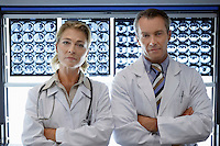 Doctors standing by brain scan images portrait