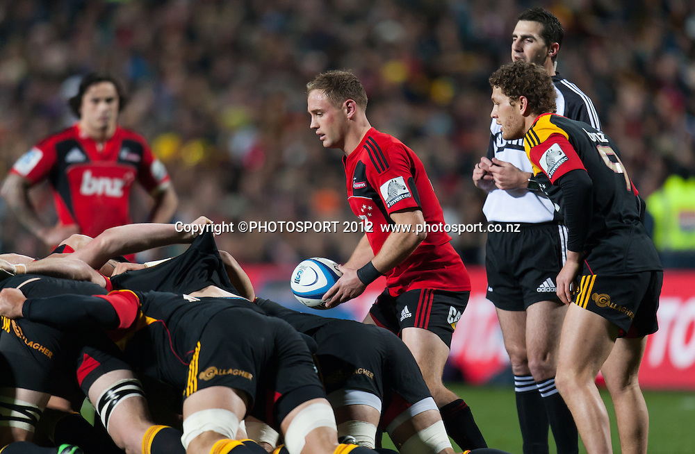 Crusaders' Andy Ellis prepares to place a scrum ball with Chiefs' Tawera Kerr-Barlow and referee Craig Joubert looking on during the Super Rugby Semi Final won by the Chiefs (20-17) against the Crusaders at Waikato Stadium, Hamilton, New Zealand, Friday 27 July 2012. Photo: Stephen Barker/Photosport.co.nz