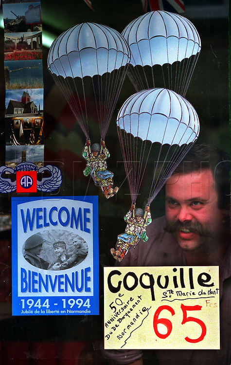 French shop owner, Philippe Dubourg,  in Ste. Marie-du-Mont with commemorative display for the 50th Anniversary of the allied invasion of France on D-Day.