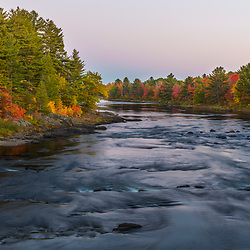 Dusk on the East Branch of the Penobscot River in Maine's Northern Forest.