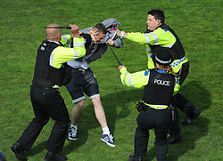 police hit a Bristol Rovers fan with a barton to try and control him. - Photo mandatory by-line: Alex James/JMP - Mobile: 07966 386802 03/05/2014 - SPORT - FOOTBALL - Bristol - Memorial Stadium - Bristol Rovers v Mansfield - Sky Bet League Two