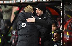 Manchester City manager Josep Guardiola embraces Bournemouth manager Eddie Howe - Mandatory by-line: Alex James/JMP - 13/02/2017 - FOOTBALL - Vitality Stadium - Bournemouth, England - Bournemouth v Manchester City - Premier League