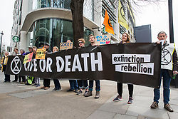 London, UK. 16th April 2019. Extinction Rebellion climate campaigners stand alongside Edgware Road during the second day of International Rebellion UK activities to call on the Government to take urgent action to address climate change.