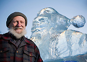 "Gabby Gaborik, Chief Elf who answers letters to ""Santa Claus"", in North Pole, Alaska. Photographed with an ice scupture of Santa Claus, in North Pole, Alaska  by Brian Smale, for People Magazine."