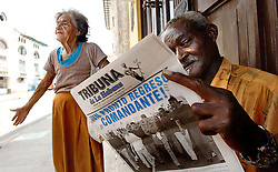 """""""A Habanero reads the political newspaper """"""""Tribuna de la Habana"""""""" while waiting for more informations about Fidel Castro in Havana, Cuba, on August 6, 2006, six days after an ailing Castro handed his brother Raul provisional control over the government which he has led uninterrupted for 47 years. Cuban citizens are waiting to find out if the 'Lider Maximo' will resume leadership after his recovery from an intestinal surgery. Photo by ABACAPRESS.COM"""" 