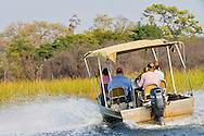 Alberto Carrera, Tourism Safari Boat, Okavango Delta, Botswana, Africa