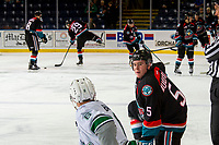 KELOWNA, CANADA - OCTOBER 10: Cayde Augustine #5 of the Kelowna Rockets kneels on the ice during warm up and speaks to Tyrel Bauer #6 of the Seattle Thunderbirds  on October 10, 2018 at Prospera Place in Kelowna, British Columbia, Canada.  (Photo by Marissa Baecker/Shoot the Breeze)  *** Local Caption ***