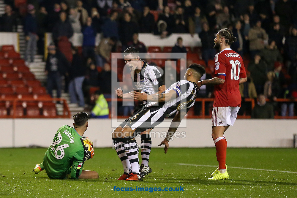 Karl Darlow of Newcastle United (left) is congratulated by his team mates after saving his second penalty of the match during the Sky Bet Championship match at the City Ground, Nottingham<br /> Picture by Andy Kearns/Focus Images Ltd 0781 864 4264<br /> 02/12/2016