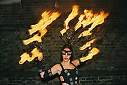 A women with flames attached to her outfit at Funktup, December 2004