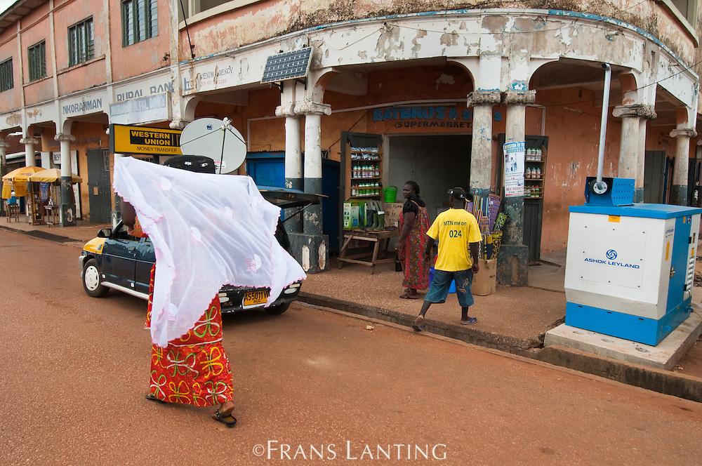 Woman adjusting veil, Ghana